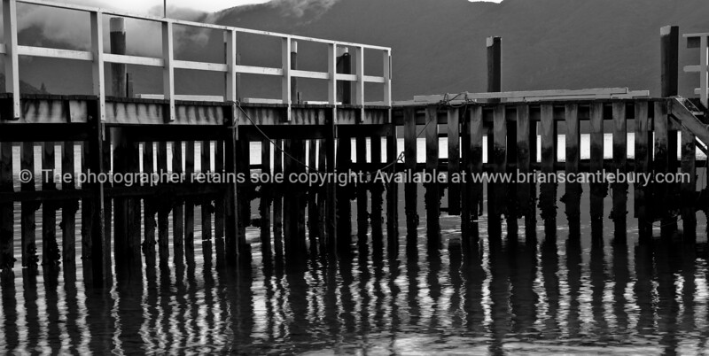 Punga Cove jetty reflections in Black and white. New Zealand images.