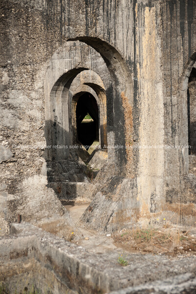 Tunnels and arches in Victoria Gold stamper Mine building. New Zealand Images.