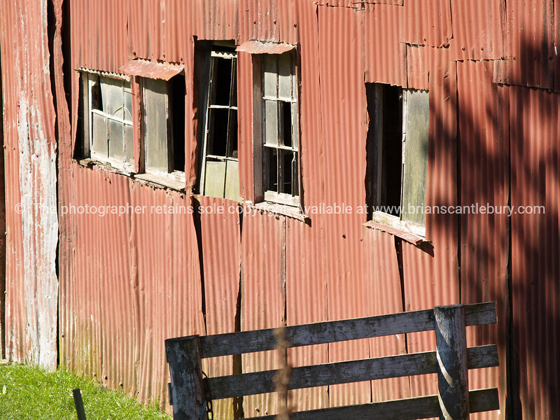 Old red corrugated iron farm shed. New Zealand images.