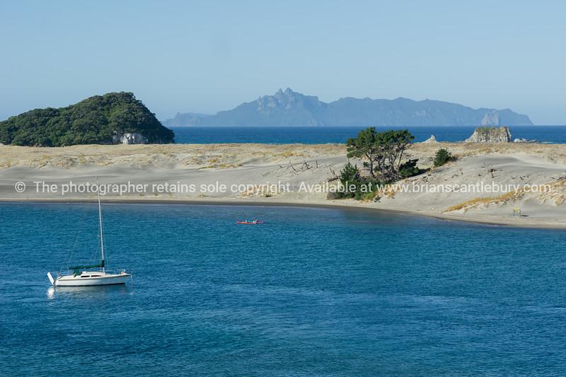 Mangawhai Heads estuary and outlook to Taranga Islandbeyond the sand dune
