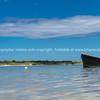 Blue dinghy afloat on peaceful calm Ngunguru estuary Northland New Zealand
