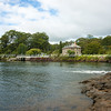 Historic Stone Store with  the causeway from other side of harbour.Northland