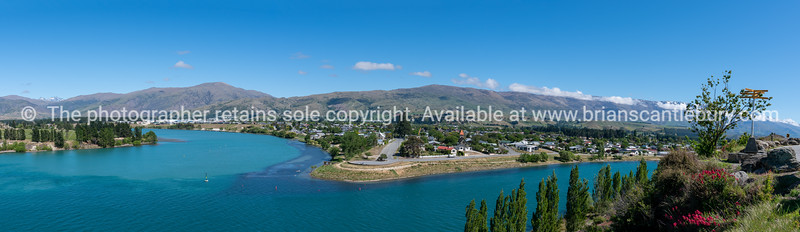 Central Otago town of Cromwell on bend in turquoise  Clutha River in Central Otago New Zealand.