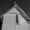 Old traditional design St Mary's Anglican Church in Waikawa building end and picket fence in monochrome