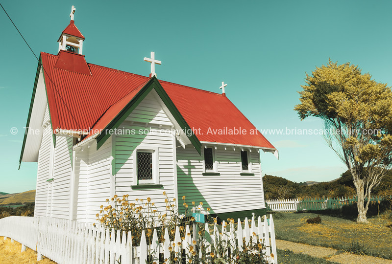 Retro effect old traditional design St Mary's Anglican Church in Waikawa with red roof and white exterior.