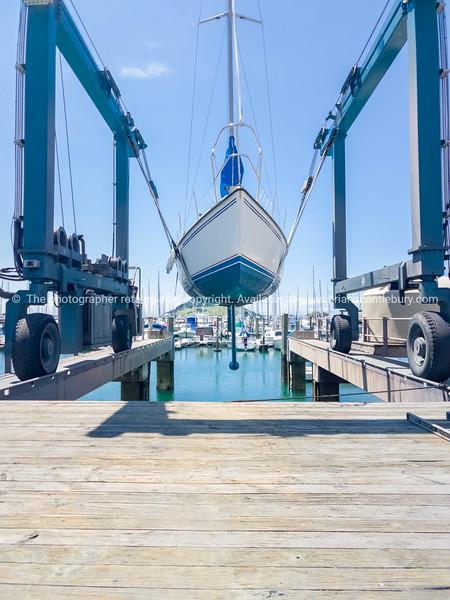 Tauranga Marina hardstand travel lift with yacht hoisted for maintenance