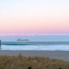 Giant cruise ship Celebrity Solstice  leaves Tauranga and is headed for horizon under beautiful morning sky.