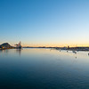 Tauranga harbour at sunrise with port facilities and landmark Mount Maunganui on golden horizon