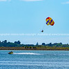 Jet ski towed paragliding obver bay.
