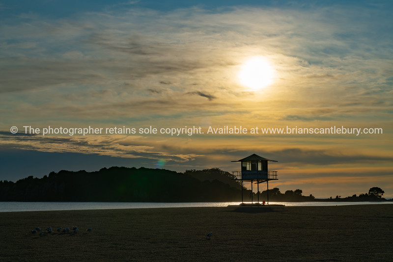 Lifesavers lookout and Leisure Island silhouetted by sunrise
