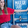 Pretty girl in red top and tatty denim shorts standing by cargo blue container