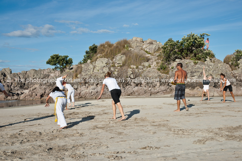 "Capoeira being practised on Mount Maunganui beach, Tauranga, New Zealand.<br /> Capoeira is a game, a sport, an art and a life philosophy, founded in Brasil in 1984. -3<br /> Model Release; no. See;  <a href=""http://www.blurb.com/b/3811392-tauranga"">http://www.blurb.com/b/3811392-tauranga</a> mount maunganui landscape photography, Tauranga Photos; Tauranga photos, Photos of Tauranga Also see; <a href=""http://www.brianscantlebury.com/Events"">http://www.brianscantlebury.com/Events</a>"