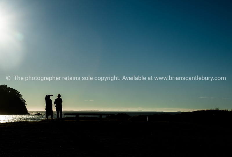 "Silhouetted form of a couple at sunrise looking along Mount Maunganui ocean beach. See;  <a href=""http://www.blurb.com/b/3811392-tauranga"">http://www.blurb.com/b/3811392-tauranga</a> mount maunganui landscape photography, Tauranga Photos; Tauranga photos, Photos of Tauranga Also see; <a href=""http://www.brianscantlebury.com/Events"">http://www.brianscantlebury.com/Events</a>"