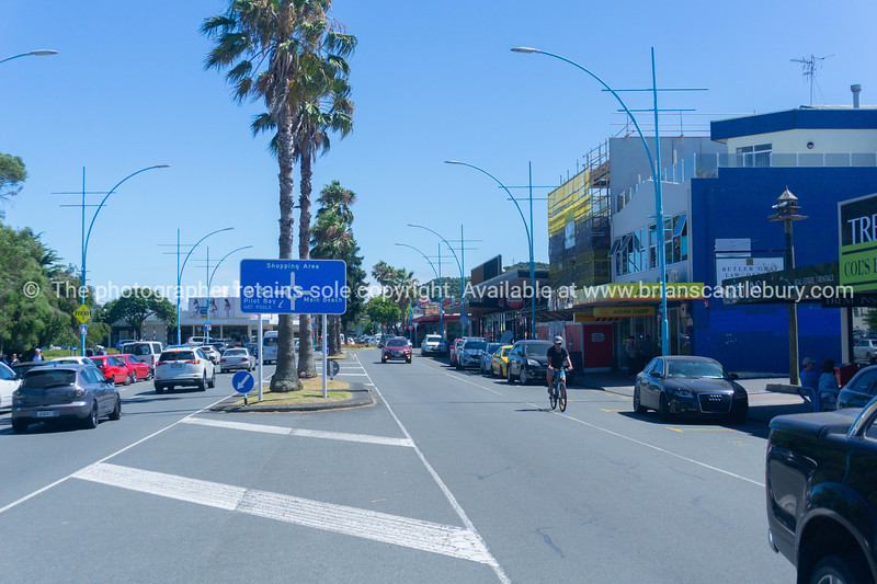 Maunganui Road with information sign directing to shopping area, Pilot Bay and Main Beach