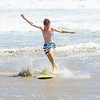 Skim-boarding in shallow water.