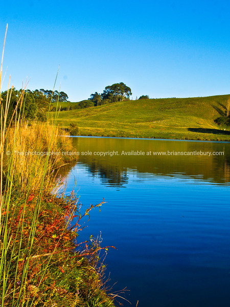 """Tauranga scenics.<br /> <br /> Mc Larens Falls Lake, Tauranga. On a clear day. Tauranga is New Zealands 5th largest city and offers a wonderfull variety of scenic and cultural experiences. Tauranga stock images Tauranga scenics. See;  <a href=""""http://www.blurb.com/b/3811392-tauranga"""">http://www.blurb.com/b/3811392-tauranga</a> mount maunganui landscape photography, Tauranga Photos; Tauranga photos, Photos of Tauranga Also see; <a href=""""http://www.brianscantlebury.com/Events"""">http://www.brianscantlebury.com/Events</a>"""