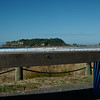"""Moturihi Island viewed over beachside bench seat from base of Mount Maunganui. The Blowhole. Tauranga is New Zealands 5th largest city and offers a wonderfull variety of scenic and cultural experiences. Tauranga stock images Tauranga scenics. See;  <a href=""""http://www.blurb.com/b/3811392-tauranga"""">http://www.blurb.com/b/3811392-tauranga</a> mount maunganui landscape photography, Tauranga Photos; Tauranga photos, Photos of Tauranga Also see; <a href=""""http://www.brianscantlebury.com/Events"""">http://www.brianscantlebury.com/Events</a>"""