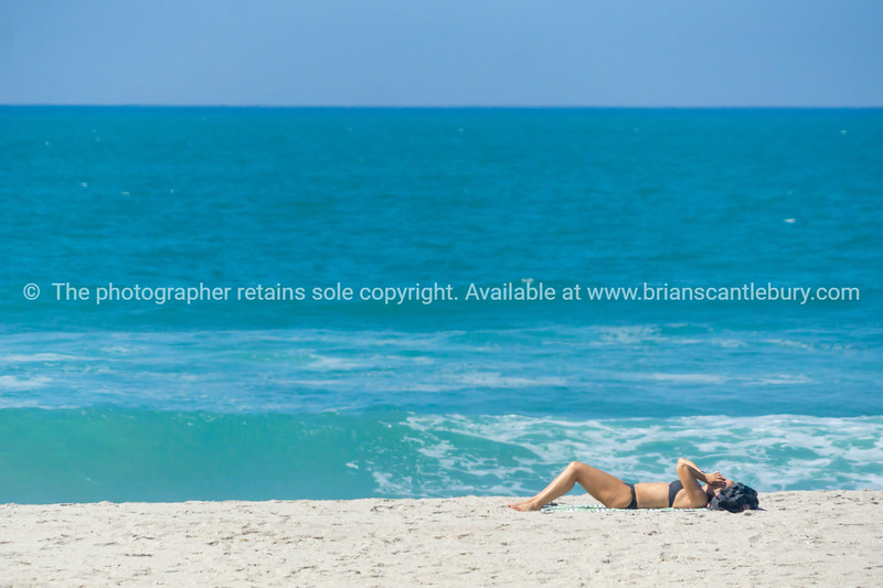 Lone sunbather on beach