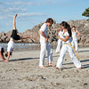 "Capoeira being practised on Mount Maunganui beach, Tauranga, New Zealand.<br /> Capoeira is a game, a sport, an art and a life philosophy, founded in Brasil in 1984. - 8<br /> Model Release; no. See;  <a href=""http://www.blurb.com/b/3811392-tauranga"">http://www.blurb.com/b/3811392-tauranga</a> mount maunganui landscape photography, Tauranga Photos; Tauranga photos, Photos of Tauranga Also see; <a href=""http://www.brianscantlebury.com/Events"">http://www.brianscantlebury.com/Events</a>"