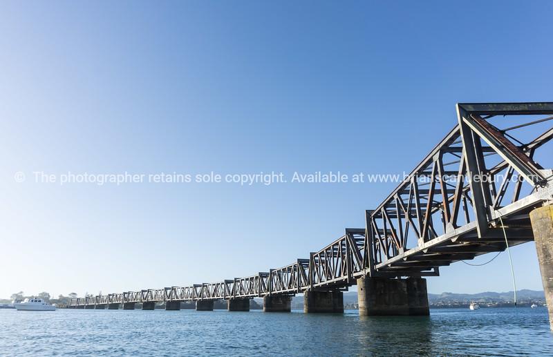 Tauranga harbour with steel railway bridge crossing