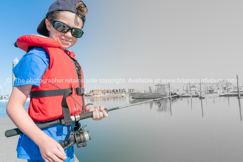 Boy on dock fishing
