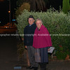 Elderly couple at their gate before dawn in rememberance of Anzac Day