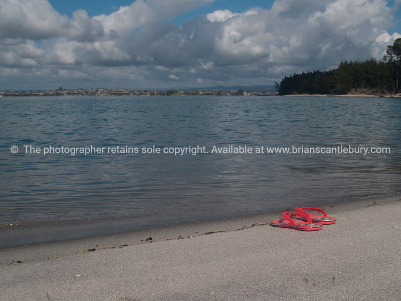 """Tauranga scenics. Deserted pink jandals, or flop flops, on sand at waters edge. See;  <a href=""""http://www.blurb.com/b/3811392-tauranga"""">http://www.blurb.com/b/3811392-tauranga</a> mount maunganui landscape photography, Tauranga Photos; Tauranga photos, Photos of Tauranga Also see; <a href=""""http://www.brianscantlebury.com/Events"""">http://www.brianscantlebury.com/Events</a>"""