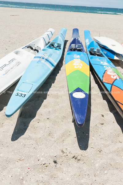 Mount Surf Live Saving Club paddle boards and boats on beach