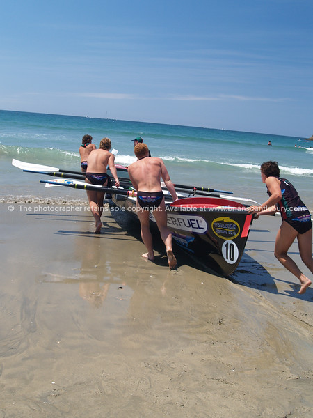 Pushing surf boat into water