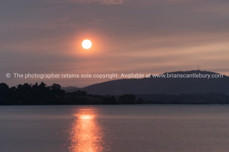 Smoke induced orange sky at sunrise