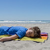 Boy lying on towel on beach