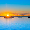 Sunrise over blue water of Tauranga harbour