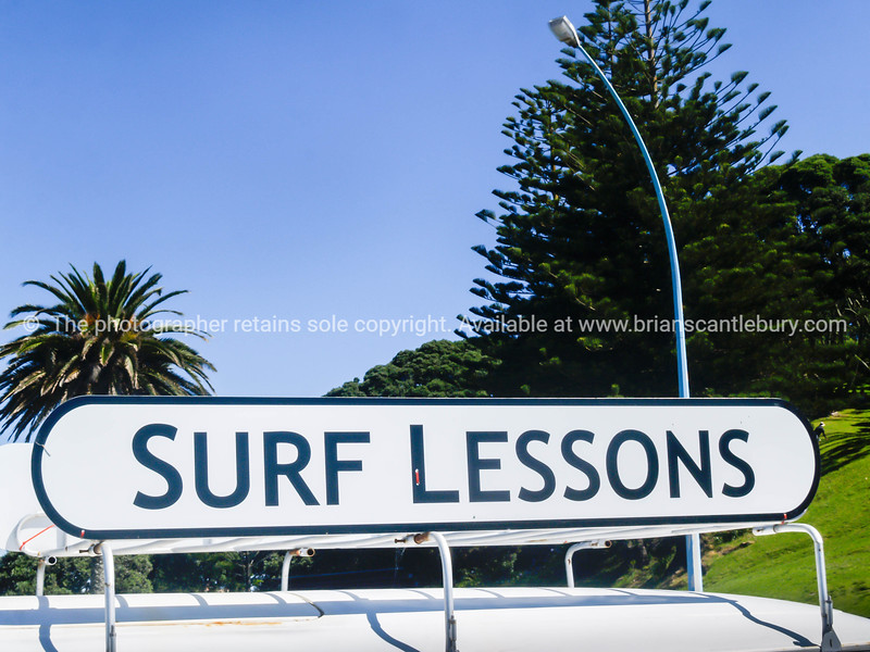 Surf lessons sign along Mount Maunganui oceanbeach