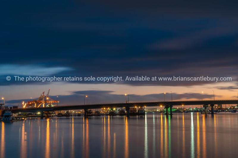 Tauranga  Harbour Bridge lights and reflections before sunrise
