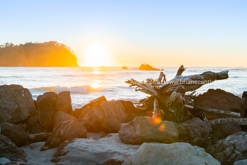 Golden sunrise over Mount Maunganui beach