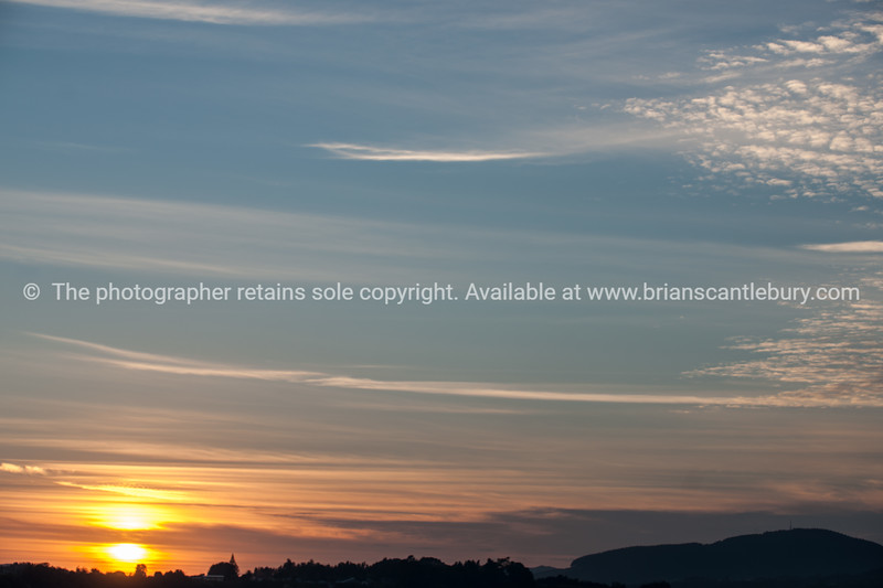 Sunsets through cirrus cloud formation.