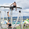 three Maori boys climbing on play equipment on Tauranga waterfront playground.