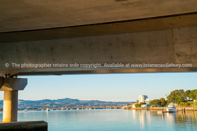 Tauranga Harbour Bridge from below over calm blue water
