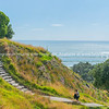 Stone steps down track up Mount Maunganui with view beyond to Pacific Ocean