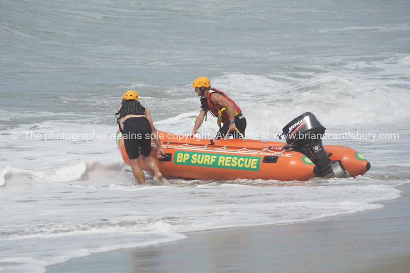 MLSC surf rescue members launching rescue inflatable.
