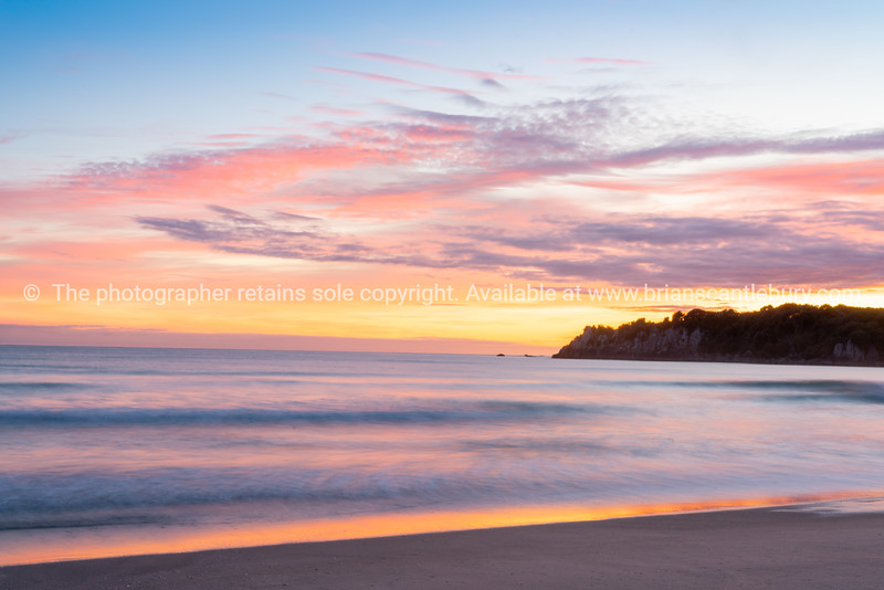 Brilliant sunrise along Mount Maunganui Mainbeach