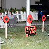 Neighbours in street before dawn in rememberance of covid 19 pandemic