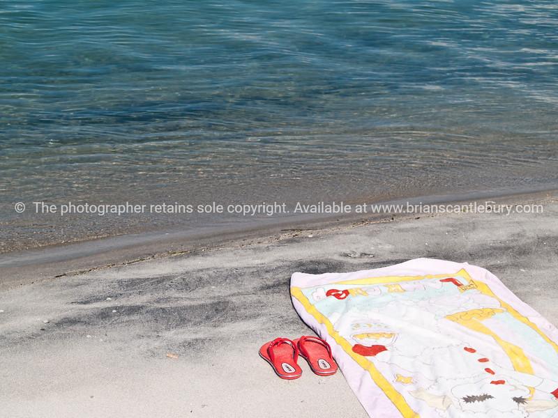 "Tauranga scenics. Beach towel and pink jandals, or flip flops, at waters edge on Matakana Island. See;  <a href=""http://www.blurb.com/b/3811392-tauranga"">http://www.blurb.com/b/3811392-tauranga</a> mount maunganui landscape photography, Tauranga Photos; Tauranga photos, Photos of Tauranga Also see; <a href=""http://www.brianscantlebury.com/Events"">http://www.brianscantlebury.com/Events</a>"