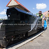 Model railway enthusiast engineers prepare vintage miniature train painted black with silver fern emblem