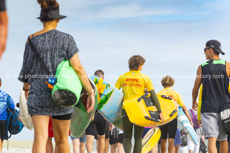Contestants and spectators for the Generation Homes Sand to Surf swim event on overcast day.