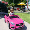 Macy in pink Mercedes battery car.