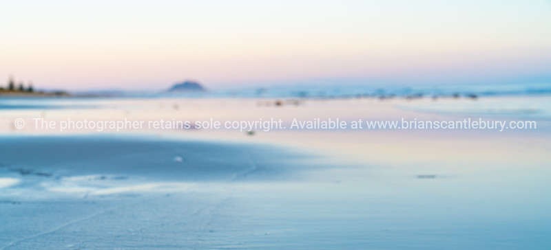 Defocused blurry background image oceanbeach long view in soft tones