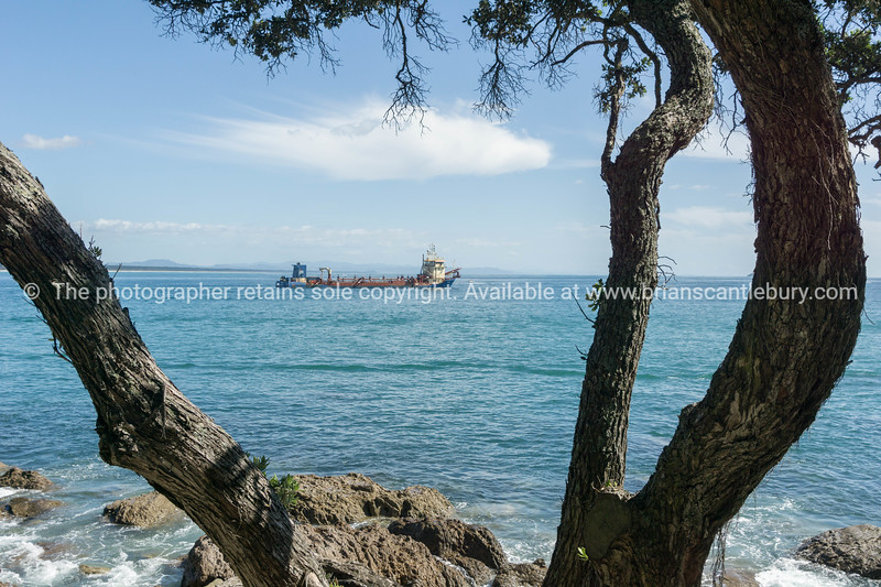 Dredge Brace R leaving Tauranga Harbour with load of sand