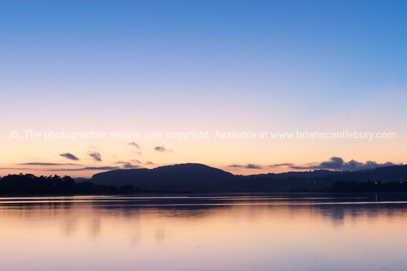 Distant hills silhouette on horizon brilliant sunrise