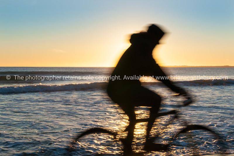 Papamoa Beach, outlok to horizon beautiful glow into into sunrise